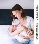aring and loving mother... | Shutterstock . vector #716611363