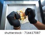 stir fried ice cream rolls at... | Shutterstock . vector #716617087