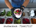 stir fried ice cream rolls at... | Shutterstock . vector #716617117