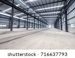 empty steel structure workshop  ... | Shutterstock . vector #716637793