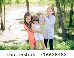 three young girl friends... | Shutterstock . vector #716638483