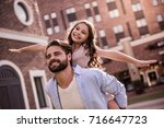 handsome bearded dad and his... | Shutterstock . vector #716647723