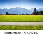 alpine meadow and road ... | Shutterstock . vector #716649157