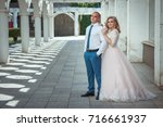 a lovely couple of newlyweds.... | Shutterstock . vector #716661937