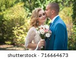 a lovely couple of newlyweds.... | Shutterstock . vector #716664673