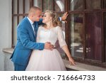a lovely couple of newlyweds.... | Shutterstock . vector #716664733