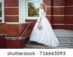 lovely young bride in wedding... | Shutterstock . vector #716665093