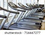 image of treadmills in a... | Shutterstock . vector #716667277