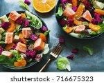 top view of two salmon  orange  ...   Shutterstock . vector #716675323
