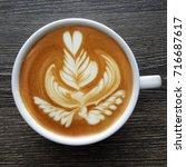 top view of a mug of latte art...   Shutterstock . vector #716687617