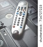 close up tv remote control on... | Shutterstock . vector #716727223