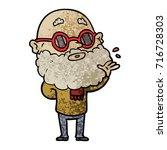 cartoon curious man with beard...   Shutterstock .eps vector #716728303