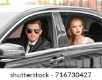 young celebrity with bodyguard... | Shutterstock . vector #716730427