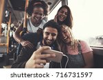 smiling group of diverse young... | Shutterstock . vector #716731597
