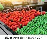strawberry  peas  cherries on... | Shutterstock . vector #716734267
