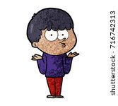 cartoon curious boy shrugging...   Shutterstock .eps vector #716742313