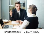 group of young financial... | Shutterstock . vector #716747827