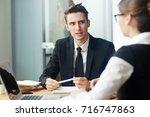 confident young entrepreneur... | Shutterstock . vector #716747863