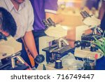 students are microscopic... | Shutterstock . vector #716749447