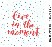 live in the moment. hand... | Shutterstock . vector #716766607