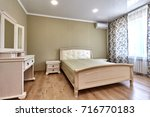 bedroom with a beautiful... | Shutterstock . vector #716770183