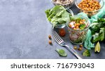 quinoa salad with chickpeas ... | Shutterstock . vector #716793043