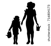 vector silhouette of family on... | Shutterstock .eps vector #716804173