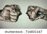Small photo of Two fists with a male and female face collide with each other on light background. Concept of confrontation, competition, family quarrel etc.