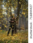 couple in the autumn forest on... | Shutterstock . vector #716844427