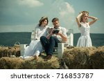 girl and man watching photos in ... | Shutterstock . vector #716853787