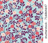 seamless floral pattern on blue ... | Shutterstock .eps vector #716864647