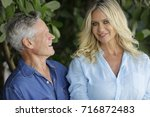 image of a mature man looking... | Shutterstock . vector #716872483