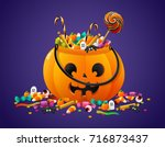 halloween pumpkin basket full... | Shutterstock .eps vector #716873437