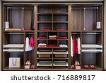 clothes in built in closet made ... | Shutterstock . vector #716889817