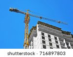 crane and building under... | Shutterstock . vector #716897803