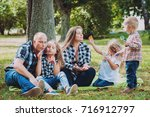 young family with cheerful... | Shutterstock . vector #716912797