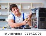 computer repairman repairing... | Shutterstock . vector #716913703