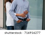 the gentle embrace of a couple... | Shutterstock . vector #716916277