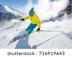 skier skiing downhill during... | Shutterstock . vector #716919643