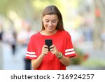 front view of a happy teen... | Shutterstock . vector #716924257