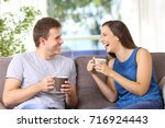 two people talking and laughing ... | Shutterstock . vector #716924443
