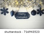 black plate  fairy light  text... | Shutterstock . vector #716943523