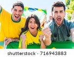 brazilian supporters... | Shutterstock . vector #716943883