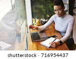 concentrated afro american... | Shutterstock . vector #716954437