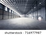 empty warehouse or storage room ... | Shutterstock . vector #716977987