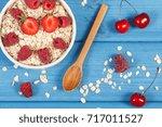 fresh prepared oatmeal and oat... | Shutterstock . vector #717011527
