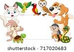 cartoon pets holding blank sign | Shutterstock . vector #717020683