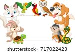 cartoon pets holding blank sign | Shutterstock .eps vector #717022423