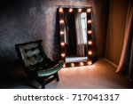green leather armchair and long ... | Shutterstock . vector #717041317