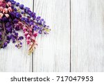 lupine flowers on a old wooden... | Shutterstock . vector #717047953